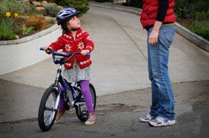 little-girl-on-bike-portrait-with-mom